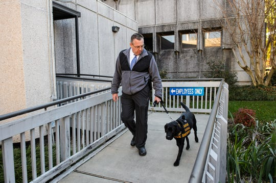 Sgt. Mike Rainey of the Greenville County Sheriff's Office walks the department's newest K9 member, Queue, to a press conference on Tuesday, Nov. 27, 2018.