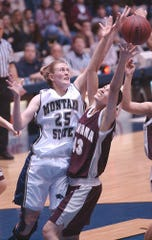 - Simarron Schildt of Montana, right, fights for a rebound against Isabel Stubbs of Montana State in February of 2002.