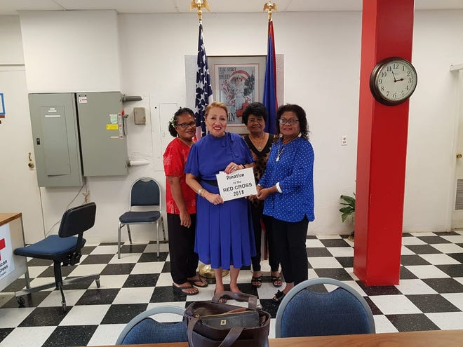 Palau Women's Club donated to the American Red Cross. Pictured from left:  Larie Pangelinan,president, Palau Women's Club; Margie Bautista, treasurer; Chita A. Blaise, CEO, American Red Cross; Ester Espangel, vice president.