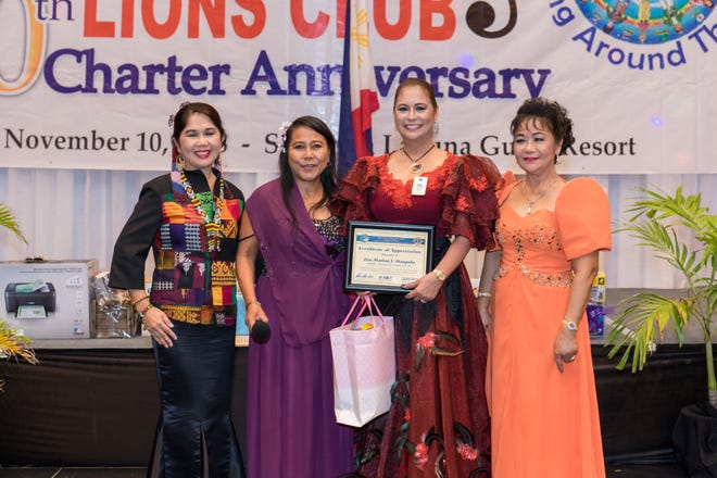 Immediate Past District Governor  Marlan Manguba of D301-A2 Philippines was the guest keynote speaker at the Guam Harmony Lions Clubs charter anniversary.  As a token of gratitude, she received a certificate of appreciation and a gift from GHLC president Michelle Hope Taitano, charter president & past district governor Lynda Tolan and event overall coordinator Region 1 Chair Loisa Cabuhat.
