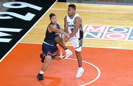 Team Guam's Earvin Jose, left, strips the ball from Fiji's Jese Sikivou during their opening game Nov. 26 at the 2018 Asia Cup Pre-Qualifier in Thailand. Guam won 93-55.