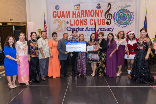 Bertha Servino won the grand prize of a roundtrip ticket to Manila courtesy of Philippine Airlines at the Guam Harmony Lions Club's  20th charter anniversary celebration Nov. 10 at Sheraton Laguna Guam Resort.  Presenting the prize were Josef Fajardo, sales & marketing director and Connie Moral of Goodwind Travel, witnessed by GHLC officers and committee members.  The net proceeds of the raffle drawing will help finance the humanitarian projects of the club.