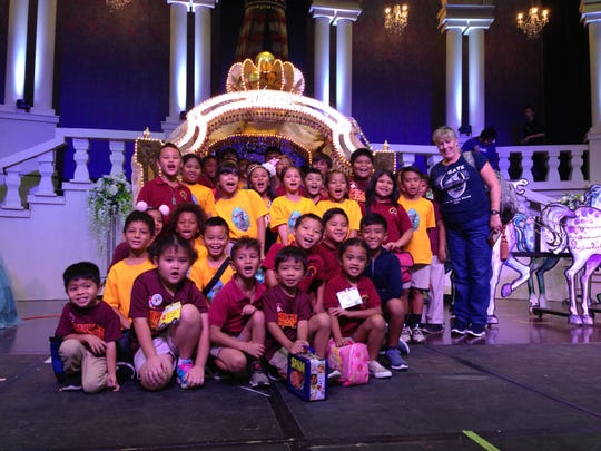 On Nov. 14 the GATE students from Captain H.B. Price Elementary School attended the live performance of the musical, Cinderella produced by the GATE VPA program and held at Father Duenas Memorial School's Phoenix Center. Front row kneeling from left: Jerrick Bascon, Isis Tudela, Damian Pomare, Samuel Salas, and Aria Gulac. 2nd row kneeling from left: Michael Clement, Anya Fernandez (partially hidden), Liam Laguana, Jaden Laniyo, Dante Calve, Sinahi King, and Xavier Yano. Third row standing from left: Ioane Camacho, Samara Bongato, Ava San Nicolas, Sophia Nangauta, Isabel Reyes, Slade DeGracia, Cyan Sablan, Vayla Gumabon, and Drady Cruz. Fourth row standing from left: Misiah Murphy, Taga Blas, Taelor Mafnas, Felicita Pangelinan, Savian Sablan, Dano Pangelinan, MollySky Dahilig, Robert O'Brien, Felix Ulloa, Kevin Zhang (hidden) Preston Pangelinan (partially hidden), and Vickie Loughran, GATE teacher.