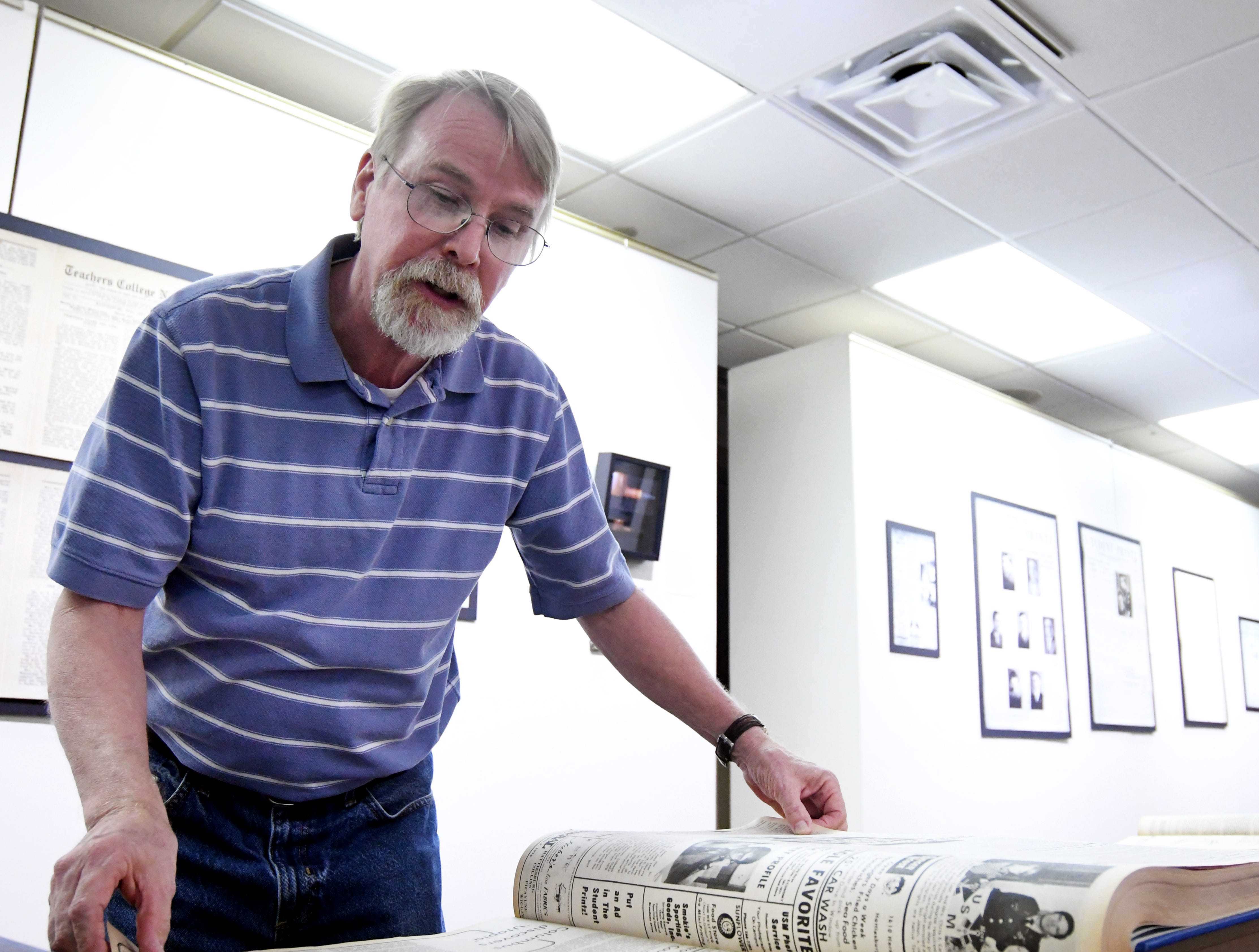 Student Printz faculty supervisor Chuck Cook looks through the newspapers archives in Cook Library at Southern Miss. The Southern Miss student newspaper, the Student Printz, celebrates 100 years in December.