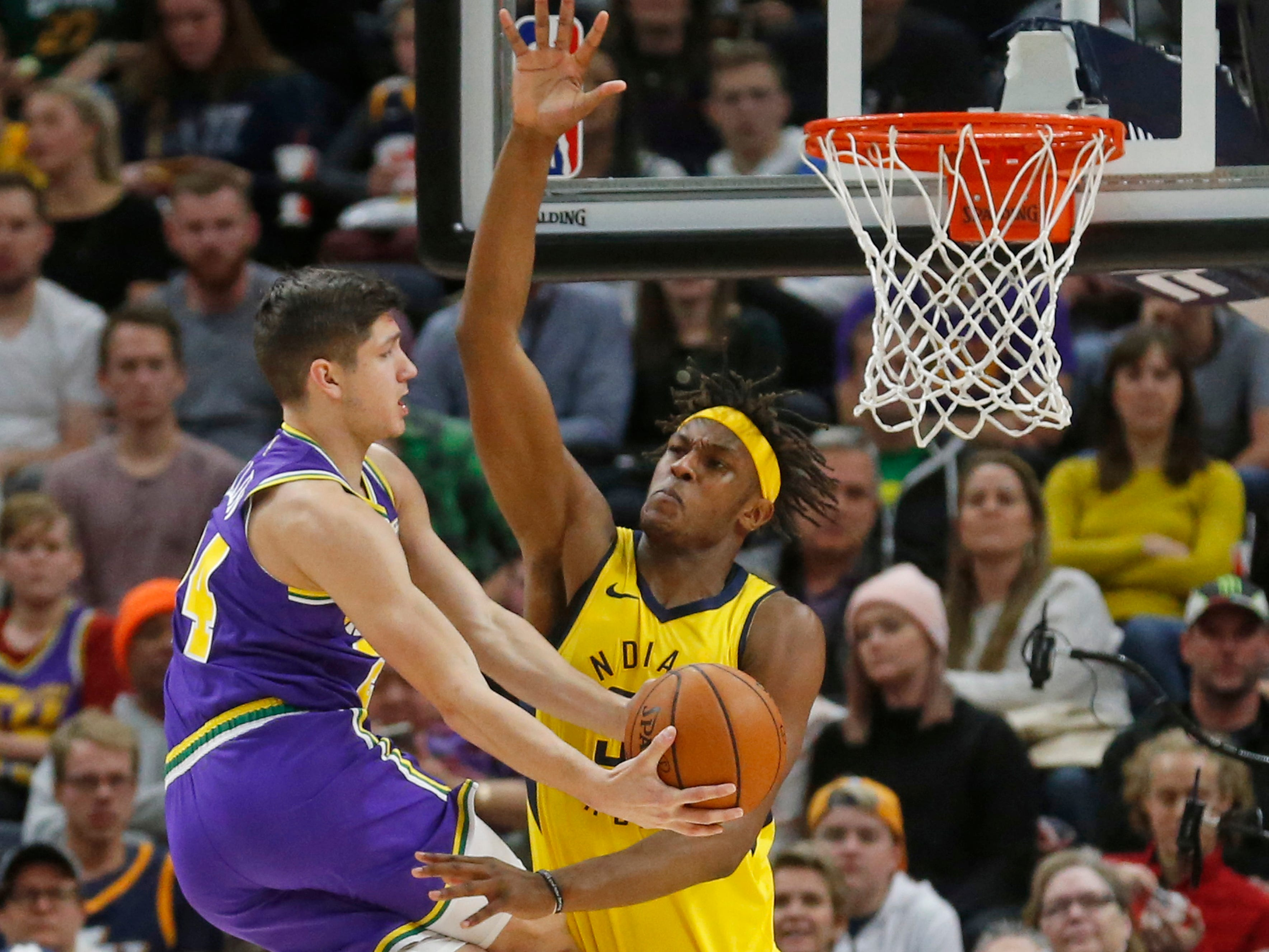 Indiana Pacers center Myles Turner, right, defends against Utah Jazz guard Grayson Allen, left, in the first half during an NBA basketball game Monday Nov. 26, 2018, in Salt Lake City.