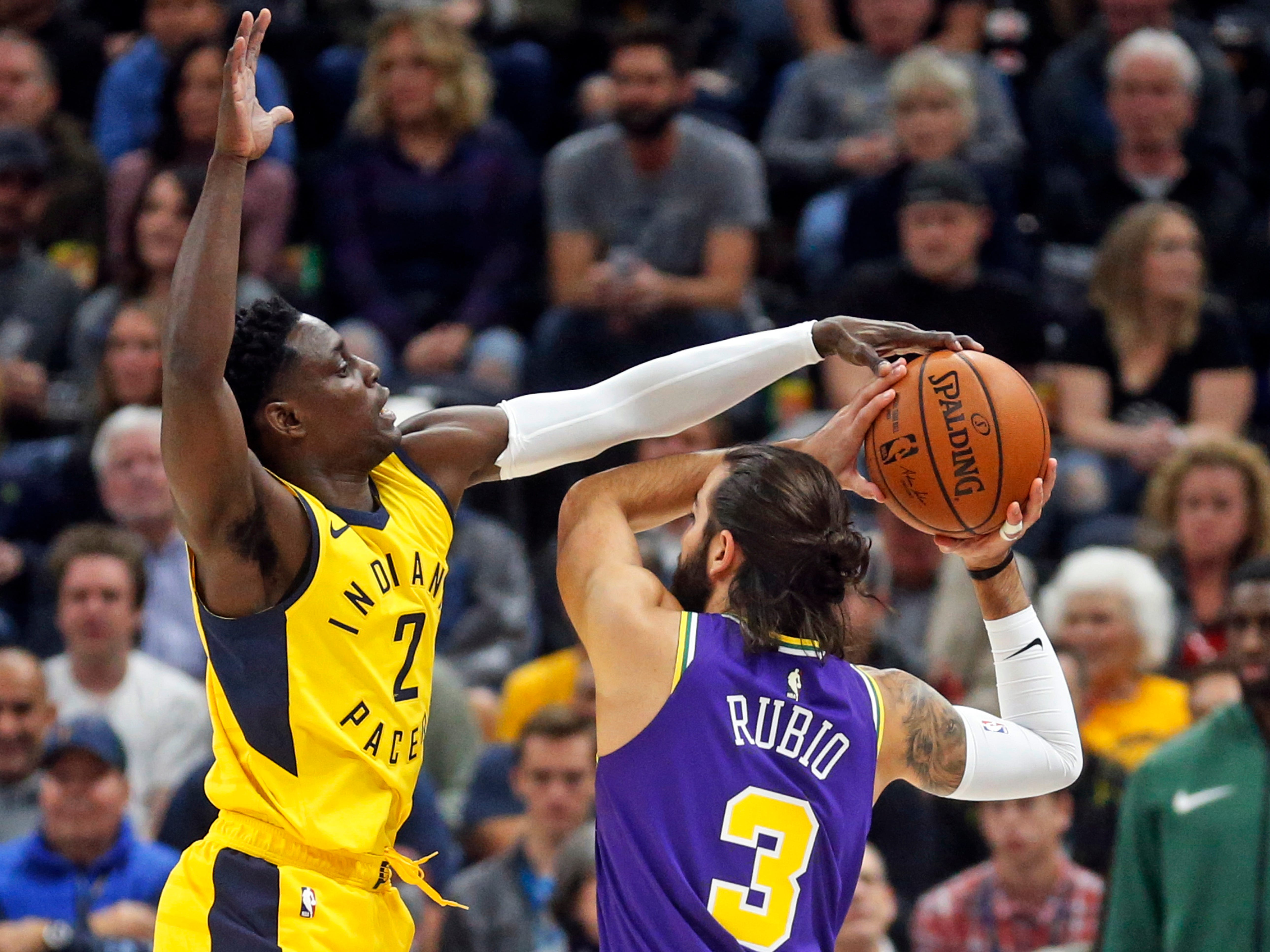 Indiana Pacers guard Darren Collison (2) defends against Utah Jazz guard Ricky Rubio (3) in the first half during an NBA basketball game Monday Nov. 26, 2018, in Salt Lake City.