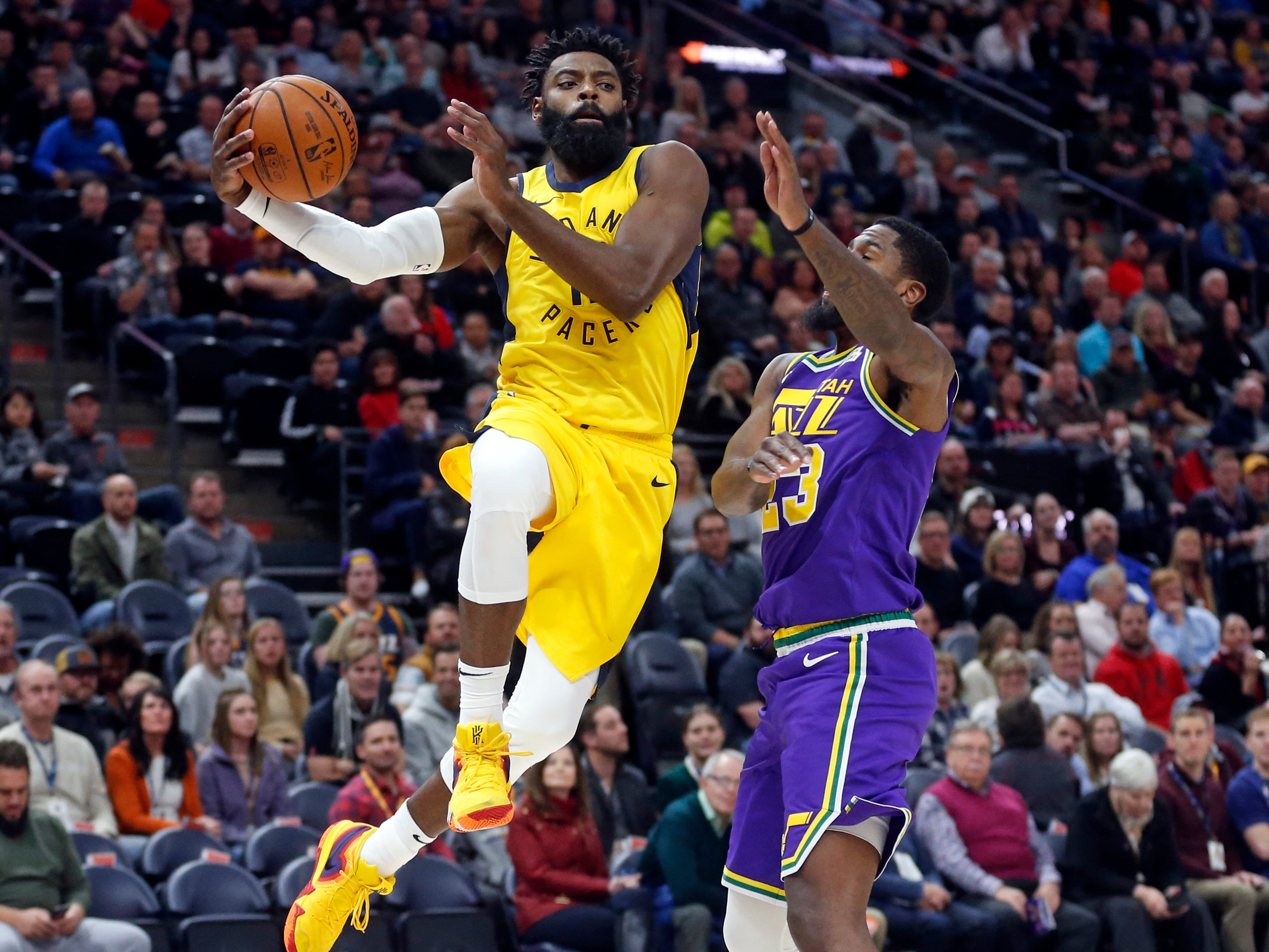 Indiana Pacers guard Tyreke Evans, left, drives to the basket as Utah Jazz forward Royce O'Neale, right, defends in the first half during an NBA basketball game Monday Nov. 26, 2018, in Salt Lake City.