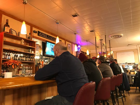 On cold, snowy days, folks fill the bar at John's Famous Stew in Indianapolis for a bowl of steaming hot beef stew.