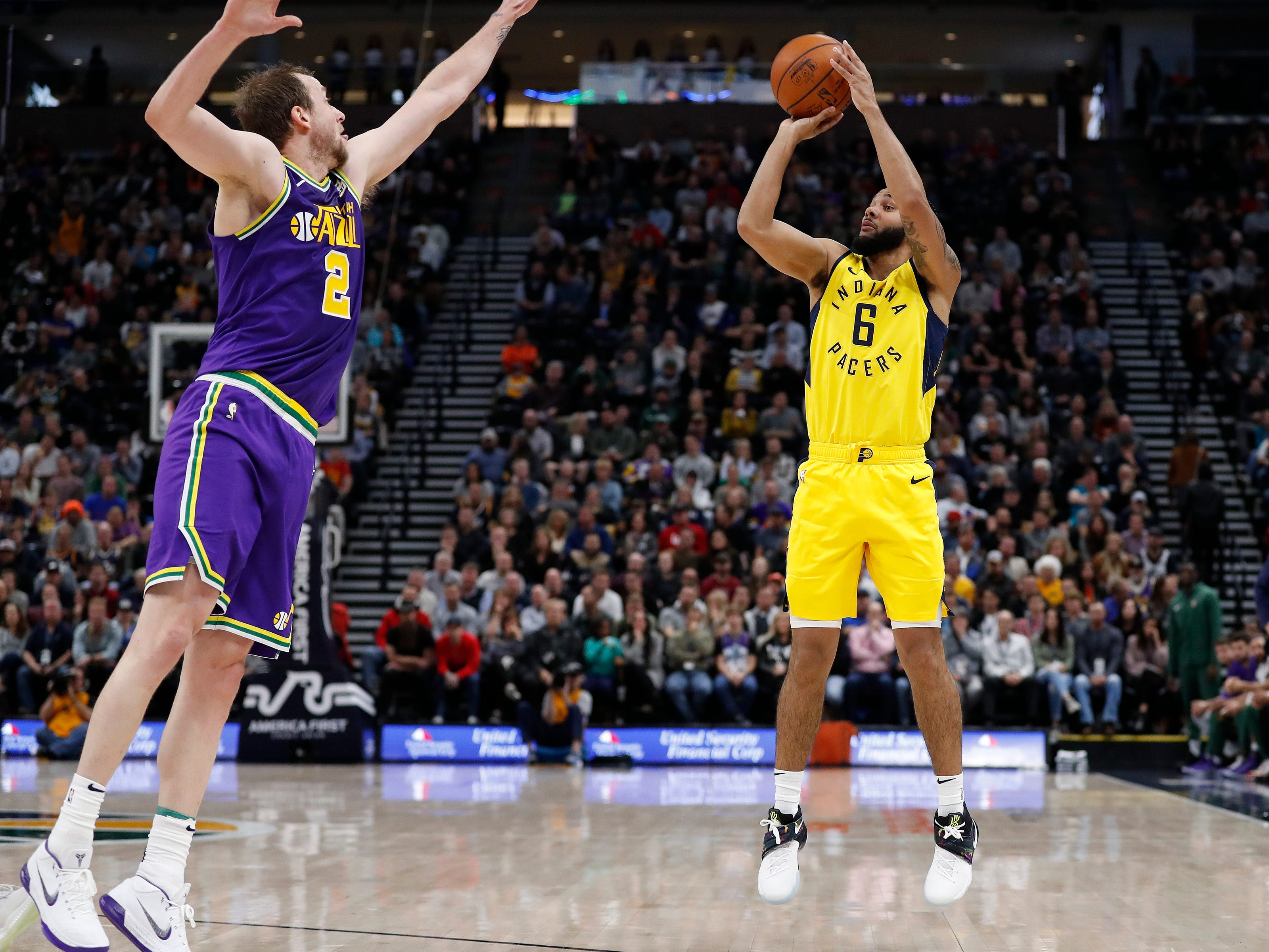 Indiana Pacers guard Cory Joseph (6) shoots a three-point shot against Utah Jazz forward Joe Ingles (2) in the second quarter at Vivint Smart Home Arena.
