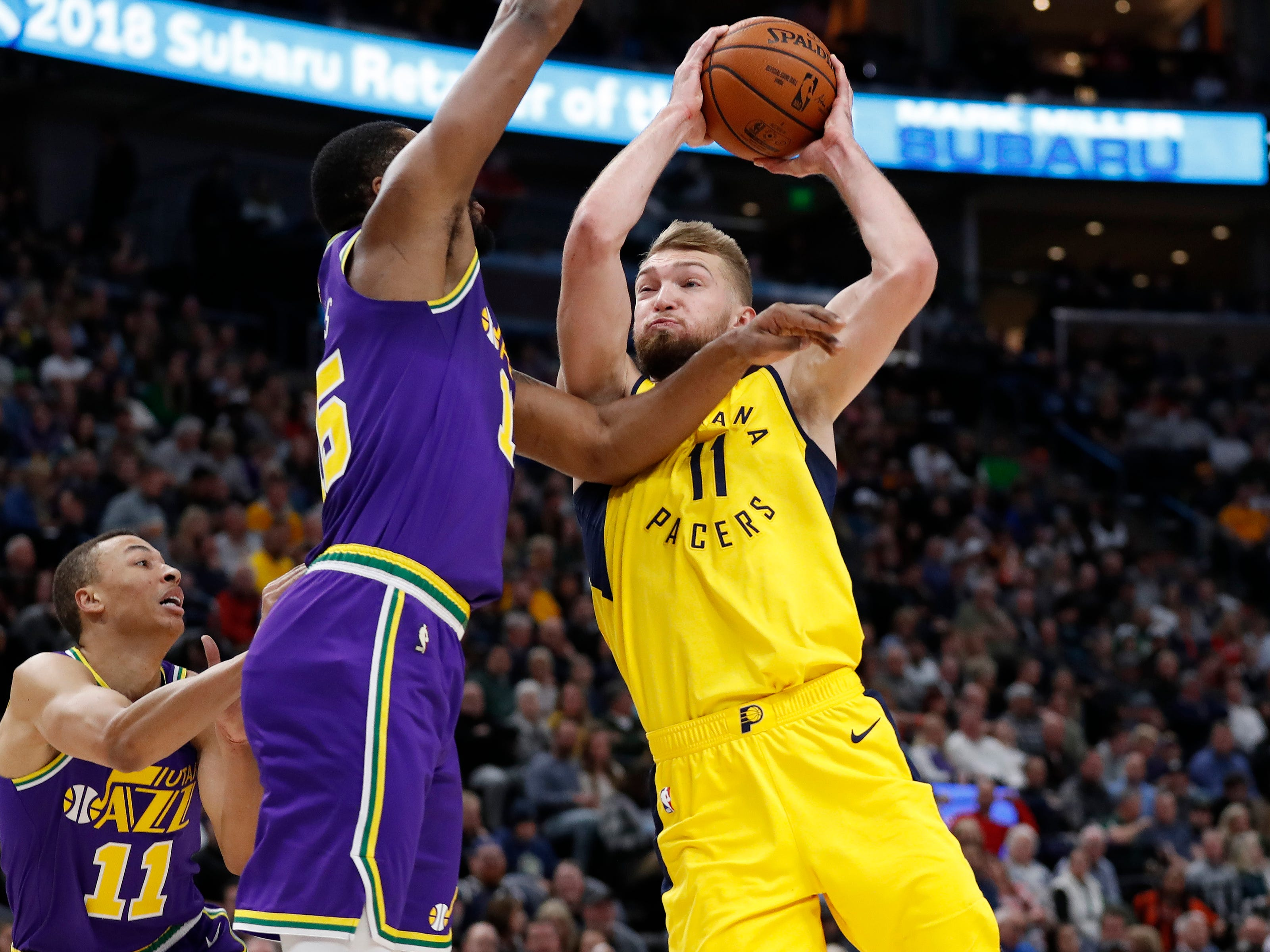 Indiana Pacers forward Domantas Sabonis (11) shoots against Utah Jazz forward Derrick Favors (15) in the second quarter at Vivint Smart Home Arena.