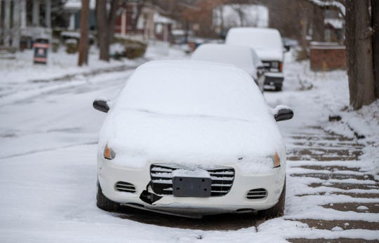 Autos and their snow, as light to moderate snow falls throughout central Indiana, Indianapolis, Tuesday, Nov. 27, 2018. Rain is expected to fall on Thursday.