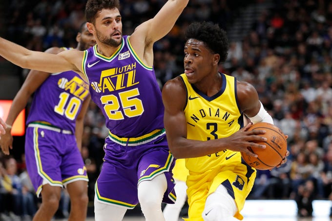 Nov 26, 2018; Salt Lake City, UT, USA; Indiana Pacers guard Aaron Holiday (3) drives to the hoop against Utah Jazz guard Raul Neto (25) in the second quarter at Vivint Smart Home Arena.