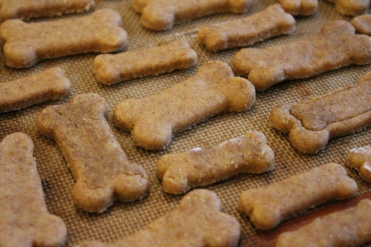 Makayla Southerland bakes dog treats with wheat flour, cornmeal, salt, olive oil, peanut butter, and eggs. She sells bags filled with treats for $3 and proceeds benefit the Humane Society of Hamilton County and other area shelters.