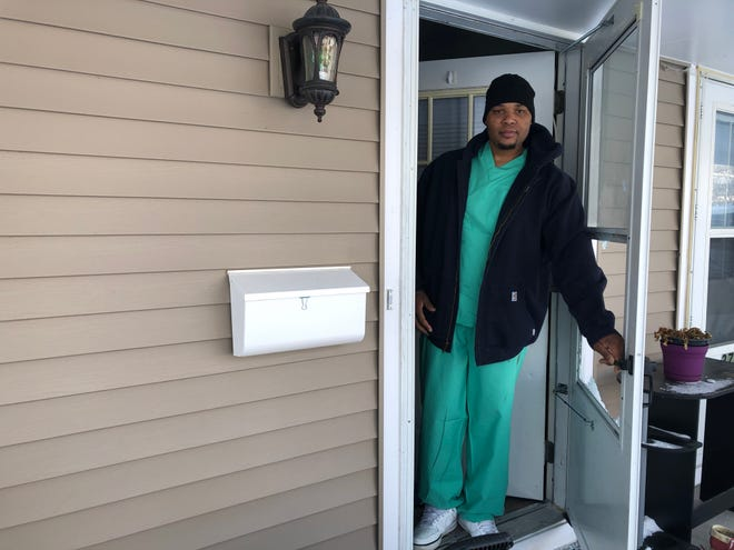 Lonnie Clark stands where he said someone shot him twice just hours earlier at his Iowa City Home Tuesday, Nov. 27.