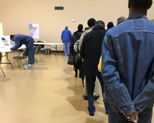 Voters stand in line to vote during a recent election in Hinds County.