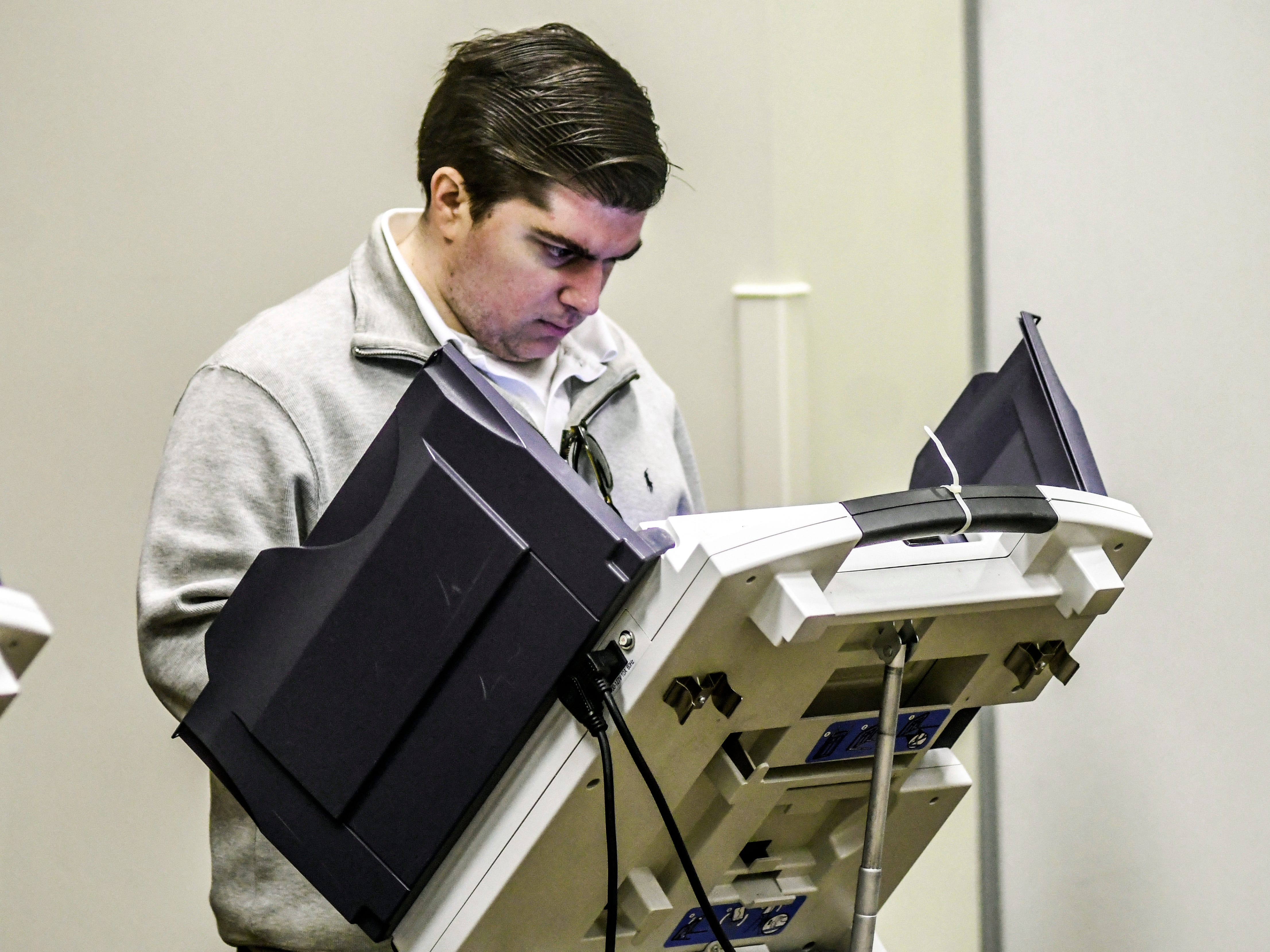 Graham Doty votes at the polls in a runoff election at the Oxford Conference Center in Oxford, Miss. on Tuesday, Nov. 27, 2018. Mississippi voters are deciding the last U.S. Senate race of the midterms, choosing between Espy and Republican Sen. Cindy Hyde-Smith.