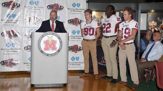 Seminary head coach Brian Rials and players Jeff Miller (19), Caleb Reardon (80) and Nathan Pickering (22) at Monday's state championship games news conference oat the Mississippi Sports Hall of Fame.