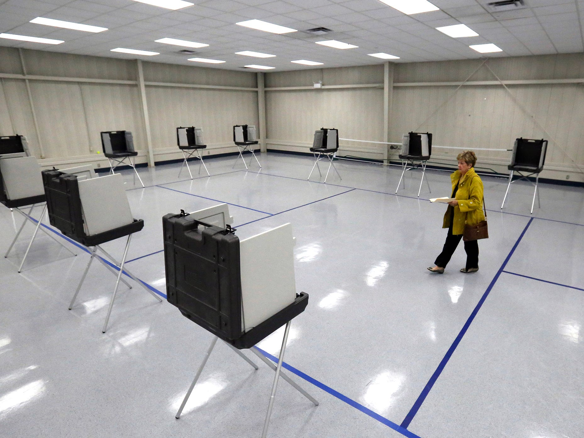 Kathleen McCann walks to cast her vote  in a runoff election Tuesday, Nov. 27, 2018 in Gulfport, Miss.  Mississippi voters are deciding the last U.S. Senate race of the midterms, choosing between Democrat Mike Espy and Republican Sen. Cindy Hyde-Smith.