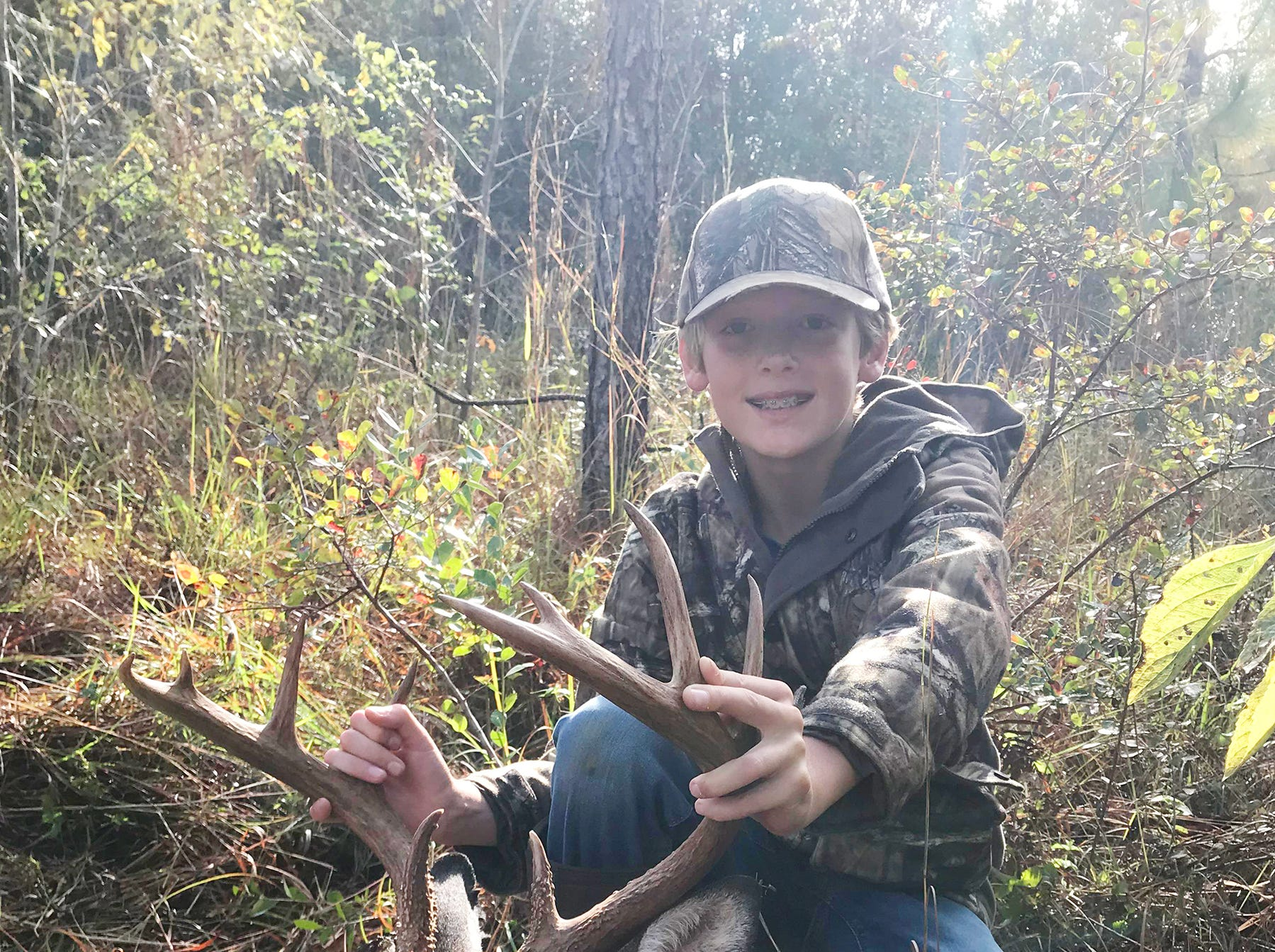 Gaines Russum, 10, of Hattiesburg, harvested a 10-point while hunting with his father this season. It was his first deer.