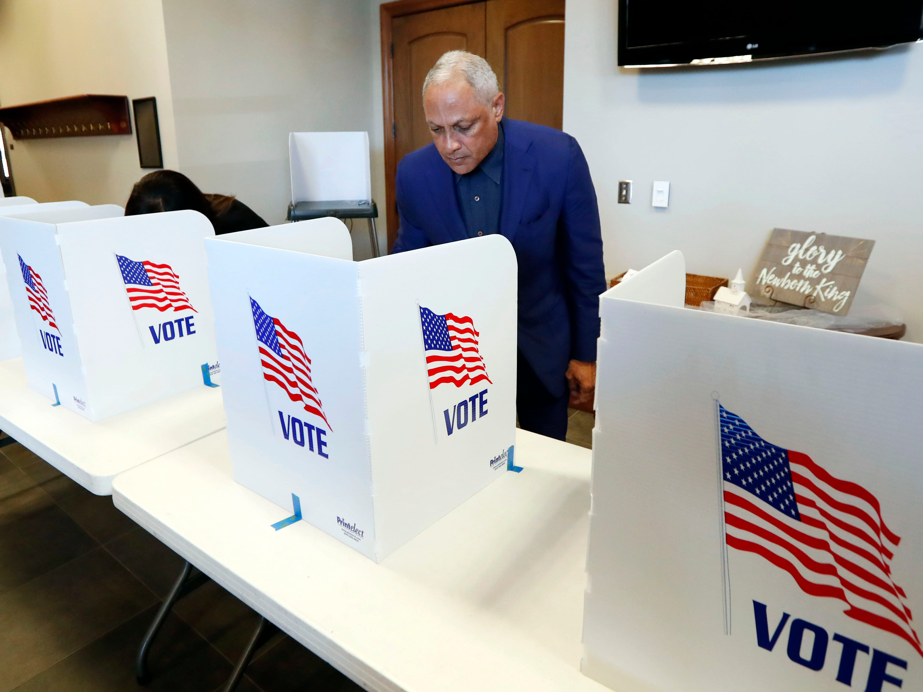 Democrat Mike Espy votes in a runoff election Tuesday, Nov. 27, 2018 in Ridgeland, Miss.  Mississippi voters are deciding the last U.S. Senate race of the midterms, choosing between Espy and Republican Sen. Cindy Hyde-Smith.