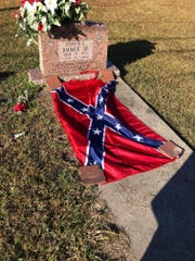 Confederate flag placed on the grave of slain civil rights leader Vernon Dahmer