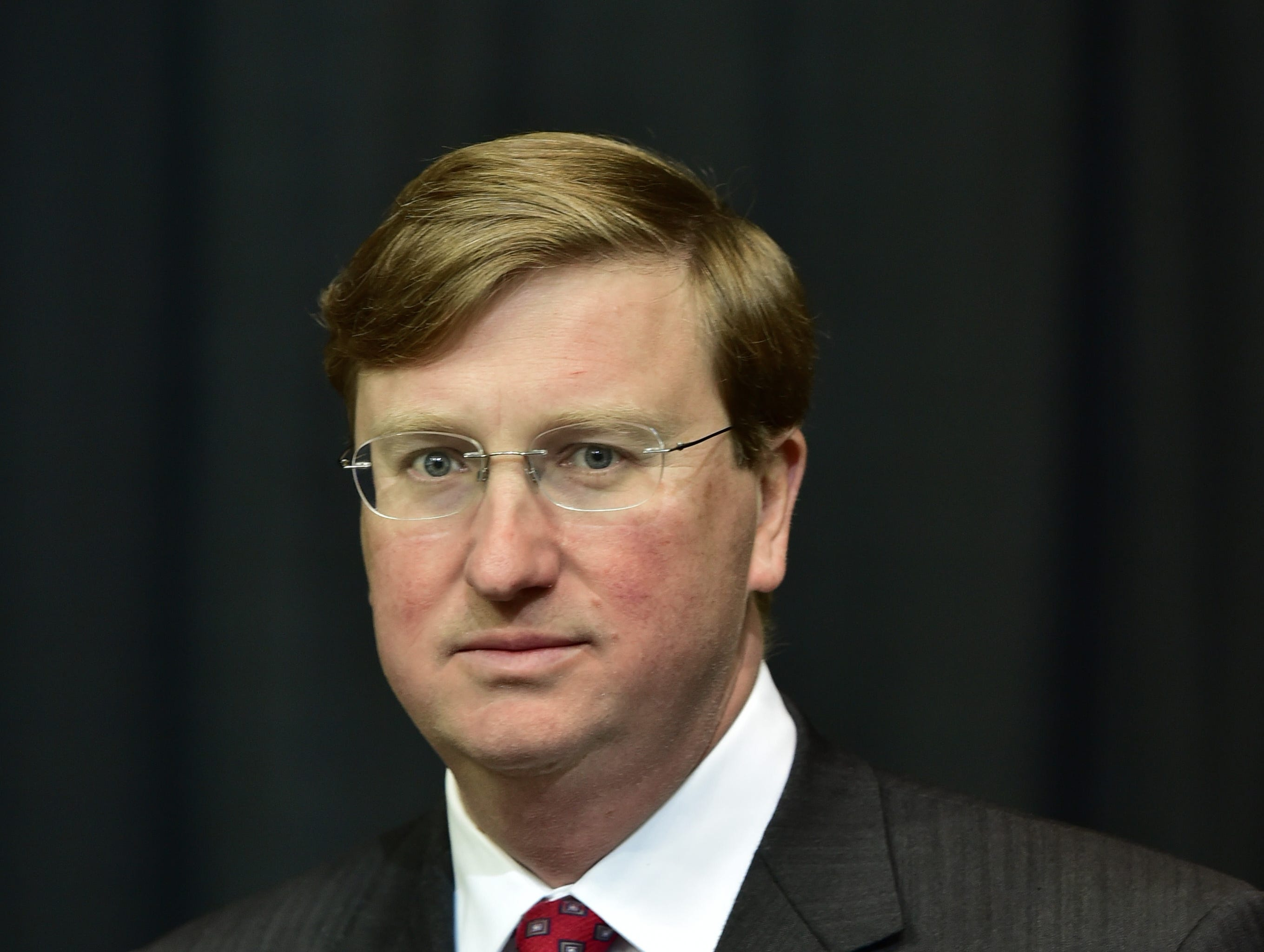 Mississippi Lt. Gov. Tate Reeves pauses before entering the stage to speak at the 'MAGA Christmas' rally at Biloxi's Mississippi Coast Coliseum. The rally was held in support of incumbent U.S. Sen. Cindy Hyde-Smith the evening before a run off between Hyde-Smith and Mike Espy for senate. Monday, Nov. 26, 2018.