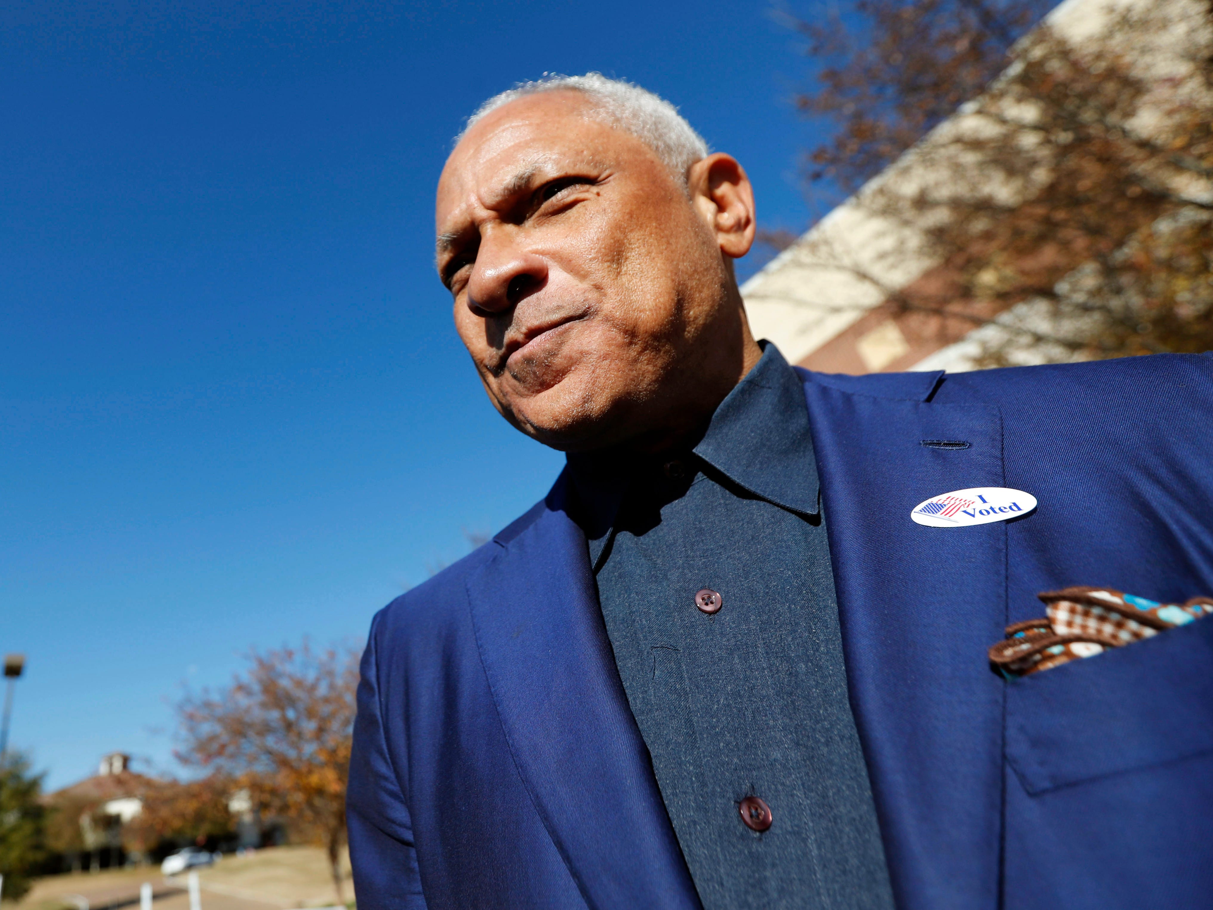 Democrat Mike Espy leaves his precinct after voting in a runoff election Tuesday, Nov. 27, 2018 in Ridgeland, Miss.  Mississippi voters are deciding the last U.S. Senate race of the midterms, choosing between Espy and Republican Sen. Cindy Hyde-Smith.