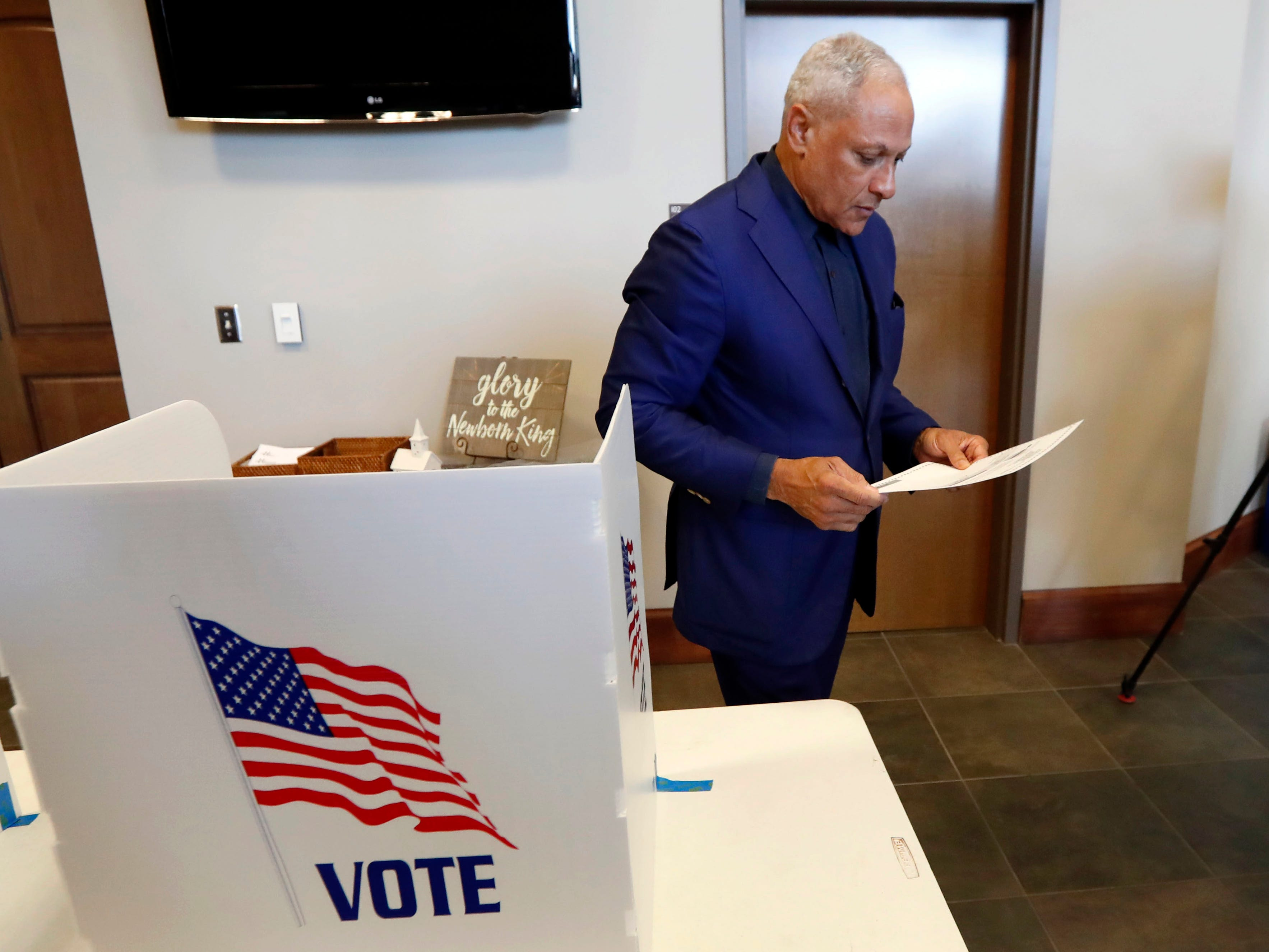 Democrat Mike Espy studies his ballot during a runoff election Tuesday, Nov. 27, 2018 in Ridgeland, Miss.  Mississippi voters are deciding the last U.S. Senate race of the midterms, choosing between Espy and Republican Sen. Cindy Hyde-Smith.