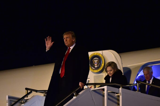 Arriving in Gulfport, President Donald Trump exits Air Force One followed by U.S. senators Cindy Hyde-Smith and Roger Wicker. President Trump visited Biloxi to speak at a rally in support of sen. Hyde-Smith who faces a runoff on Tuesday against Mike Espy. Monday, Nov. 26, 2018.