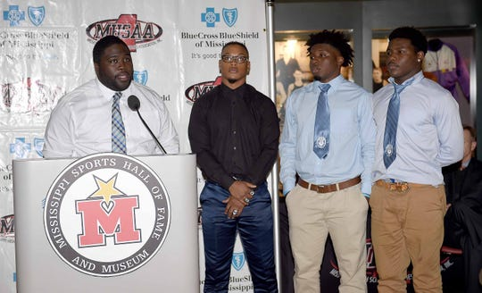 Simmons head coach Timothy Johnson introduces players (from left) Aaron Davis, Stemarion Edwards and Tyus Levy at a Monday news conference  at the Mississippi Sports Hall of Fame.