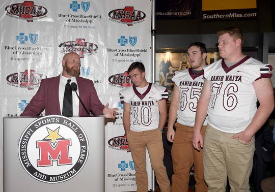 Nanih Waiya head coach James Courtney talks about players Caleb Warren (76), Kyle Holdiness (55) and Coley Taylor (10) during a Monday news conference at the Mississippi Sports Hall of Fame.