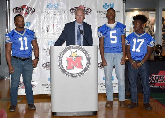 Water Valley head coach Brad Embry introduces players Javarius Benson (11), Tay Rucker (17) and Bud Tolbert (5) at the state championship games news conference Monday, at the Mississippi Sports Hall of Fame.