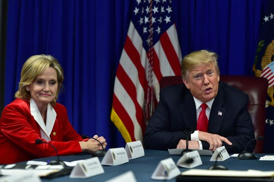 President Donald Trump speaks to fellow panelsits of a criminal justice reform round table held at the Mississippi Air National Guard basr in Gulport prior to a 'MAGA Christmas' rally in Biloxi at the Mississippi Coast Coliseum in support of U.S. Sen. Cindy Hyde-Smith's runoff against Mike Espy for senate. Monday, Nov. 26, 2018.