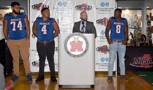 Scott Central head coach Devin Cooper and players Martavious Barlow (4), Carson Williams (74) and Navonteque Strong (8) meet the media at a Monday news conference at the Mississippi Sports Hall of Fame.