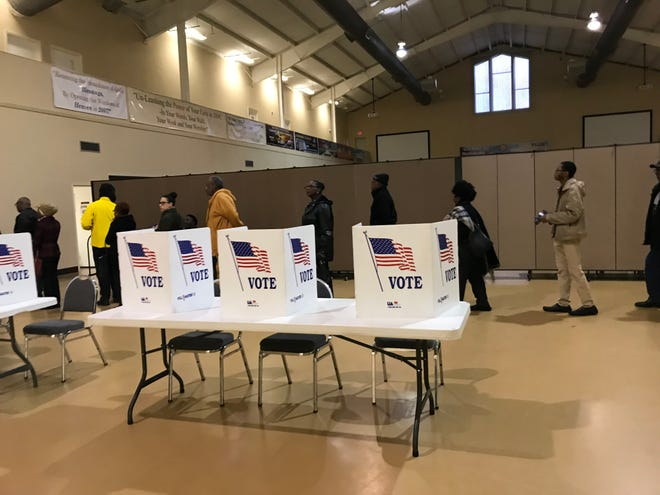 Voters wait in line at a polling precinct in north Jackson. Two Republicans vying to be the next secretary of state -- which oversees voting in Mississippi -- are trading barbs in attack ads on the campaign trail ahead of the Aug. 6 primary.
