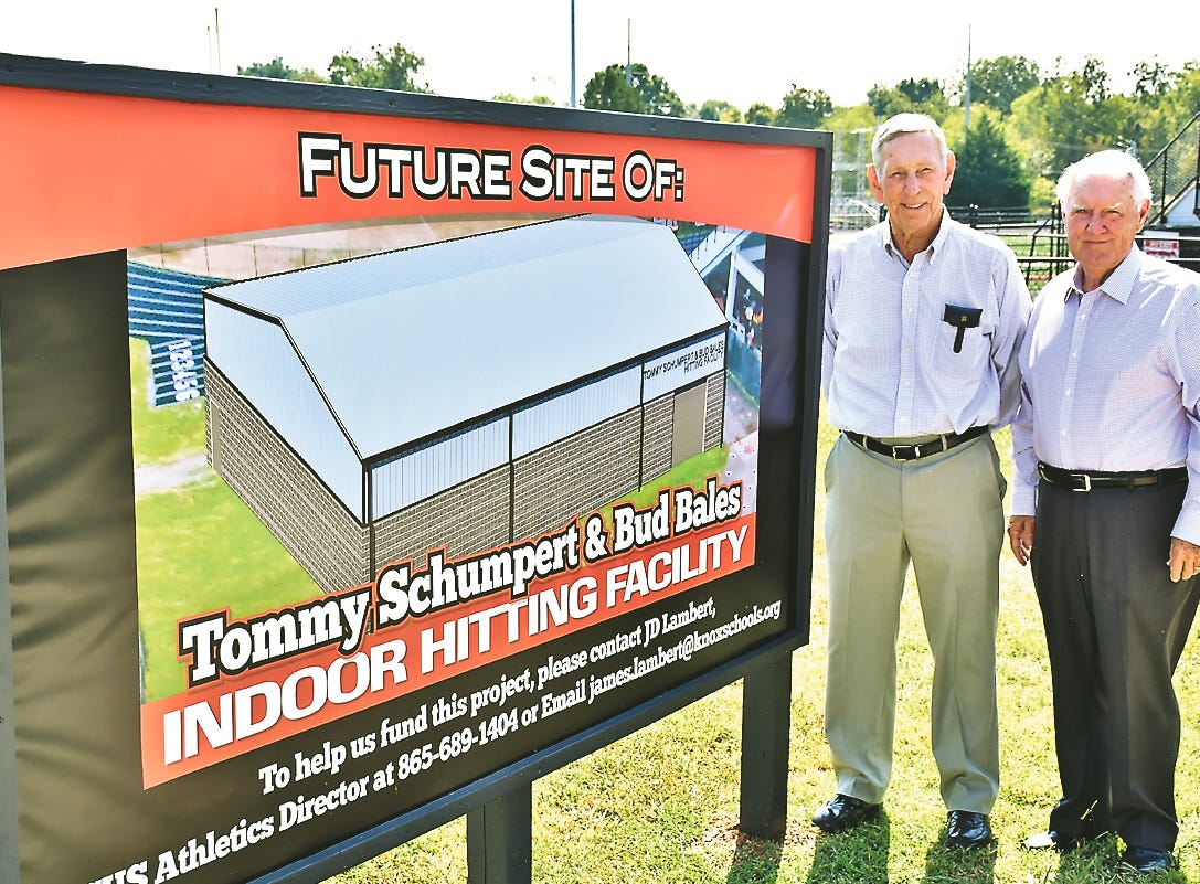 Bud Bales, left, and Tommy Schumpert stand beside the sign on the Central High campus announcing the indoor hitting facility to be built. The project began in 2015 and opened in November, 2018.