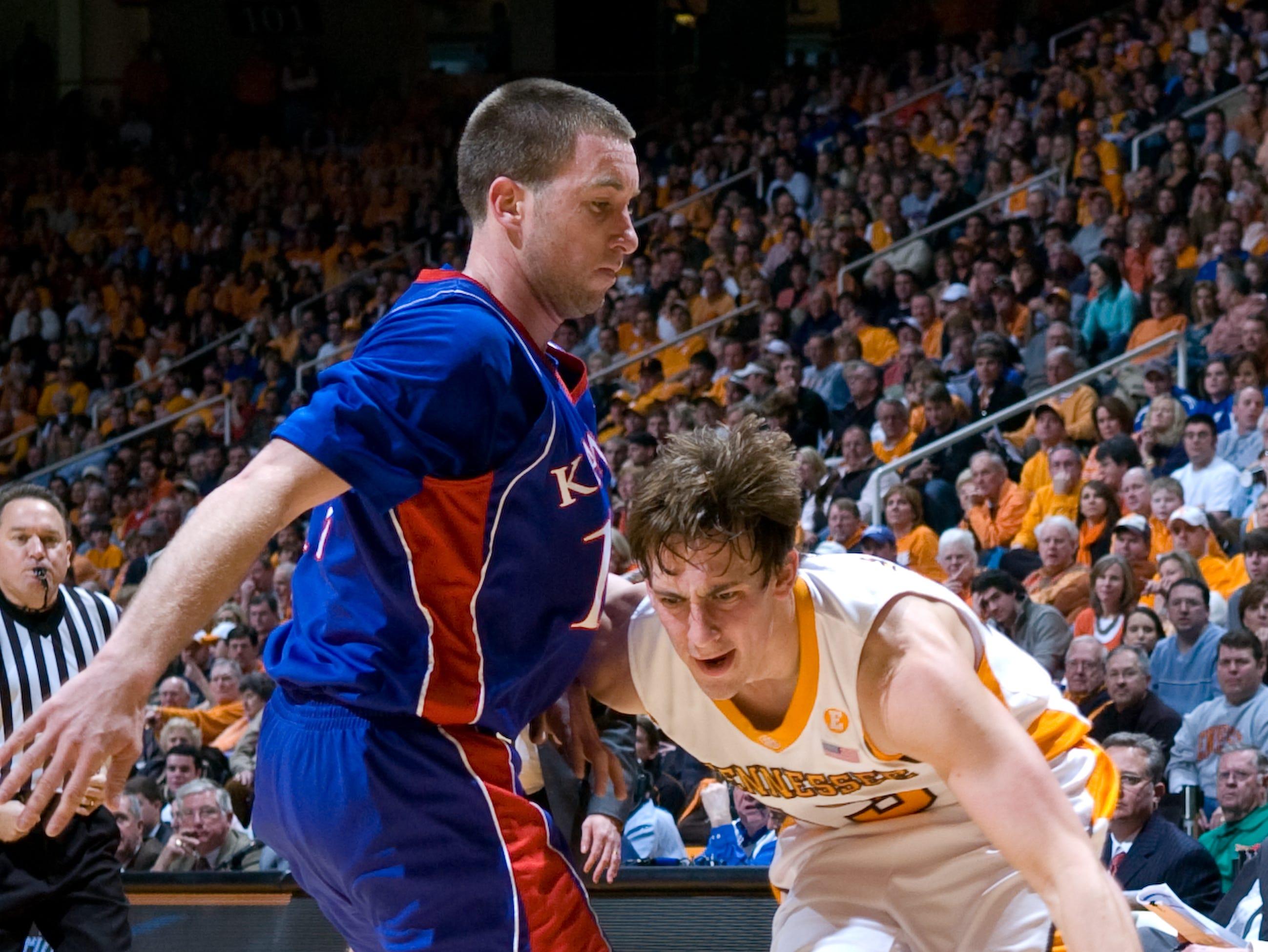 Skylar McBee tries to get past Kansas' Brady Morningstar. Tennessee upsets number one ranked  Kansas 76-68 at Thompson-Boling Arena  Sunday, Jan 10, 2010.