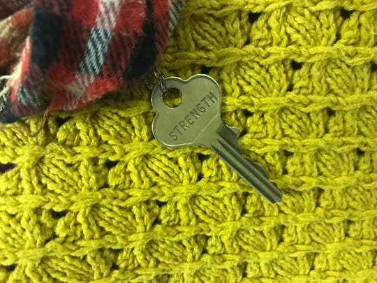 Erin Wigley wears this key on a chain, a gift from a friend, to remind her she is stronger than depression and suicide.
