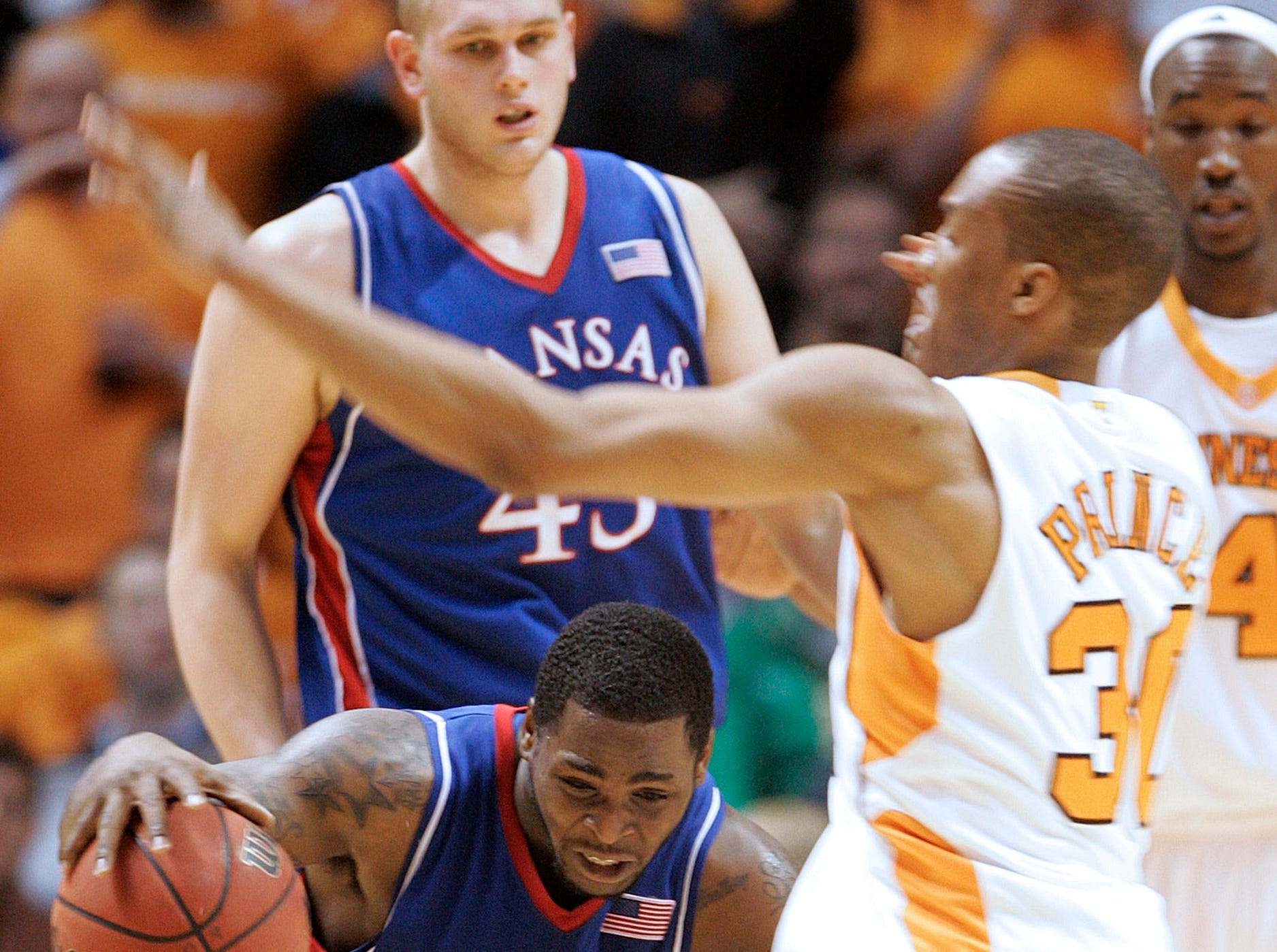 Kansas' Sherron Collins (4) tries to avoid Tennessee's J.P. Prince, right, during the second half of an NCAA college basketball game Sunday, Jan. 10, 2010, in Knoxville, Tenn. Tennessee won 76-68.