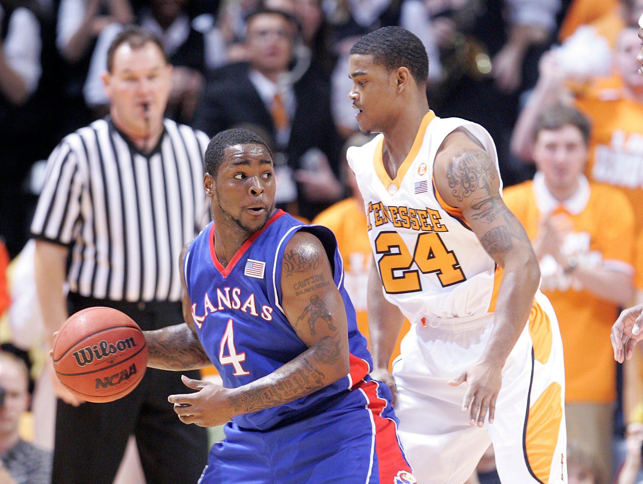 Kansas' Sherron Collins (04) drives against Tennessee Josh Bone (24) during the first half of an NCAA college basketball game Sunday, Jan. 10, 2010 in Knoxville, Tenn.