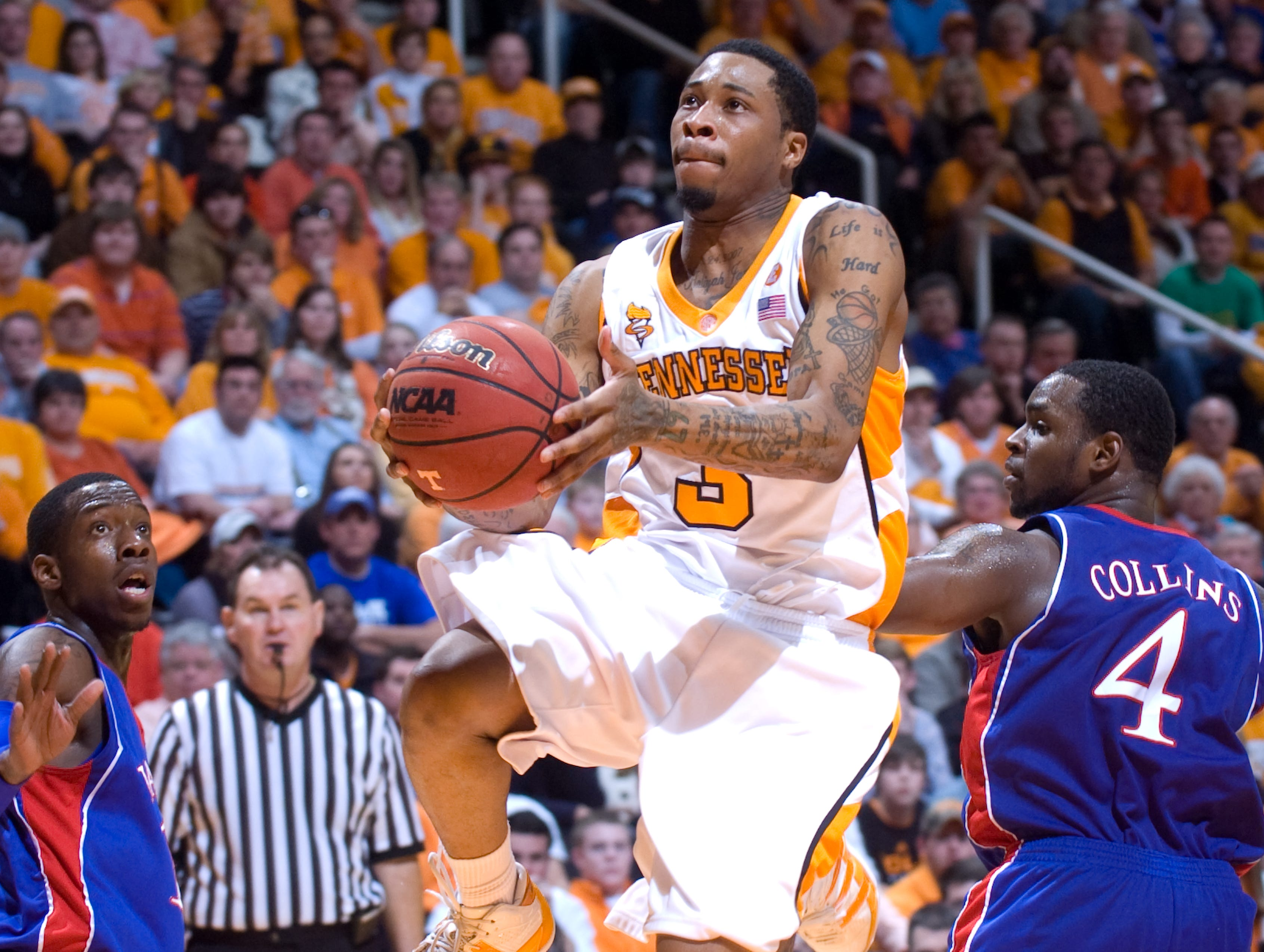 Tennessee's Bobby Maze takes to the air for the basket after getting past Kansas' Sherron Collins. Maze had 16 points, 8 assists, and 7 rebounds. Tennessee upsets number one ranked  Kansas 76-68 at Thompson-Boling Arena  Sunday, Jan 10, 2010.