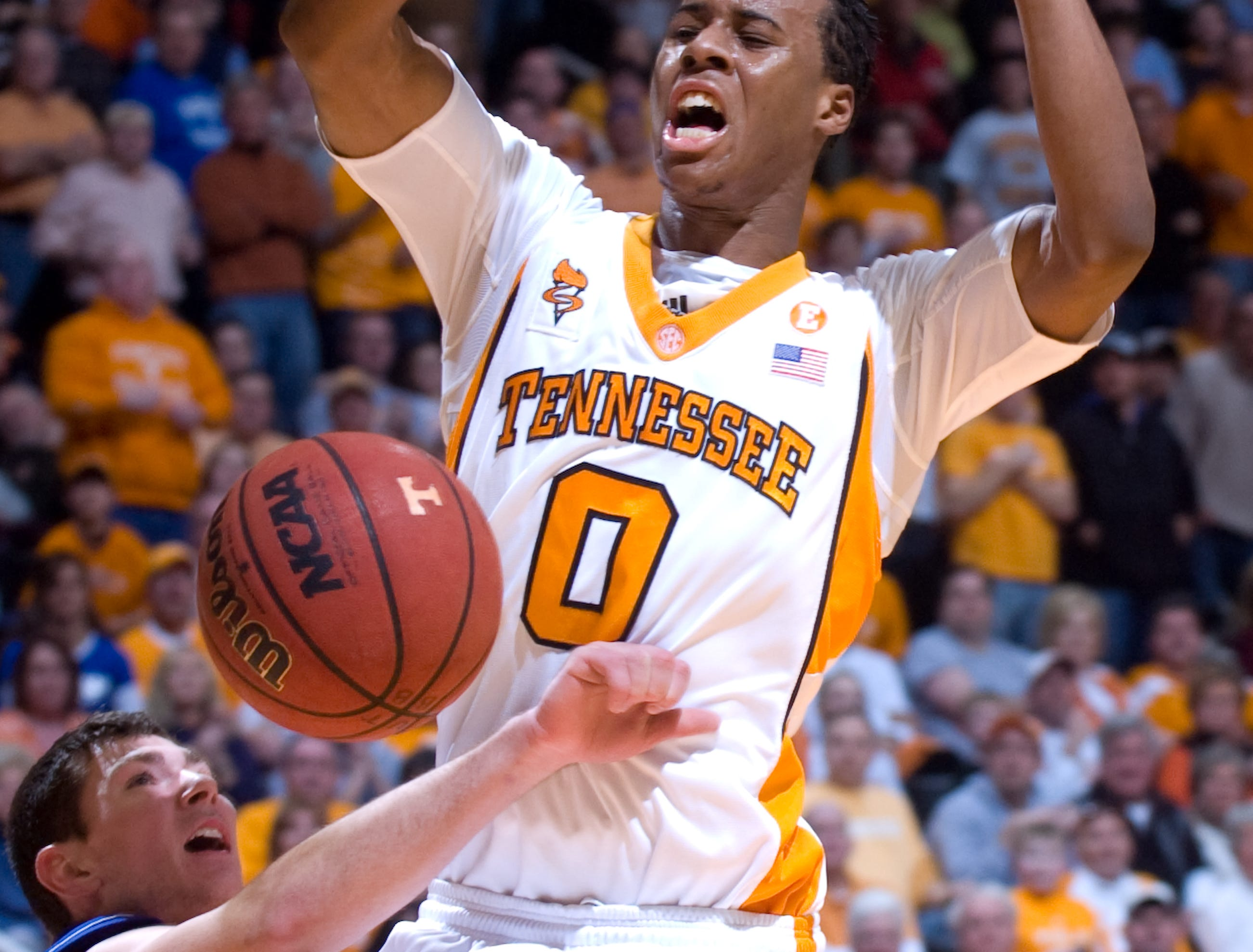 Renaldo Woolridge loses the ball as he is fouled by Kansas' Tyrel Reed. Tennessee upsets number one ranked  Kansas 76-68 at Thompson-Boling Arena  Sunday, Jan 10, 2010.