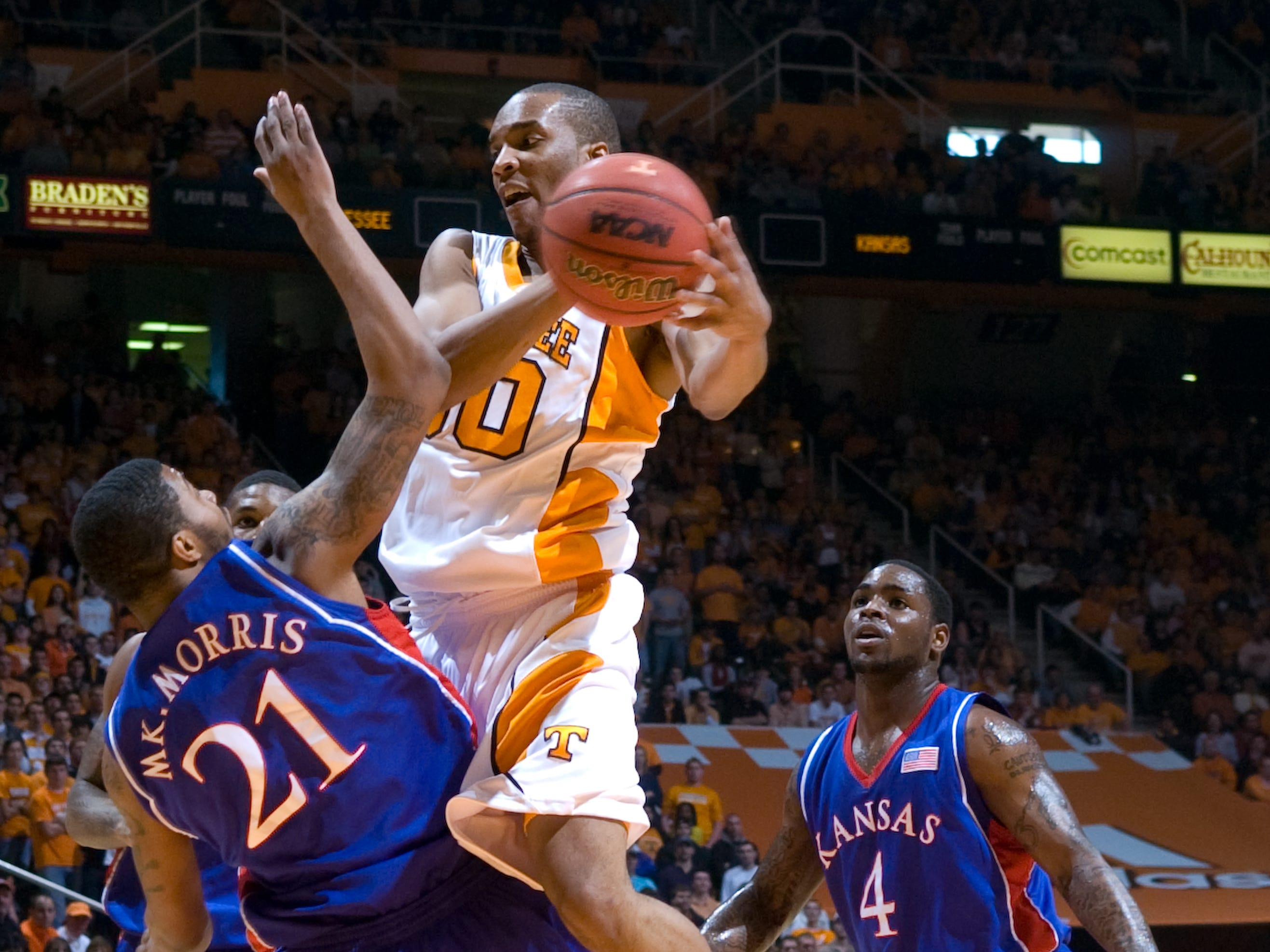 J.P. Prince runs into Kansas' Markieff Morris while driving towayds the basket. Prince had 8 points and 2 assists. At right is Kansas' Sherron Collins. Tennessee upsets number one ranked  Kansas 76-68 at Thompson-Boling Arena  Sunday, Jan 10, 2010.