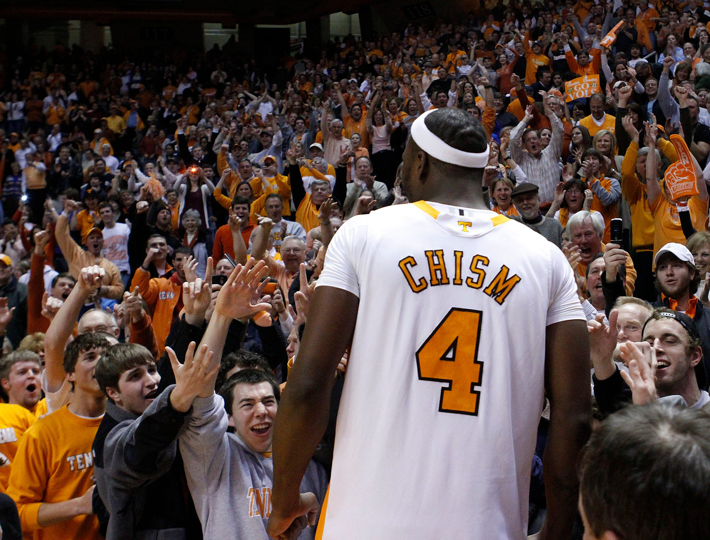 Tennessee's Wayne Chism (4) celebrates with fans after Tennessee's 76-68 win over Kansas in an NCAA college basketball game Sunday, Jan. 10, 2010, in Knoxville, Tenn.