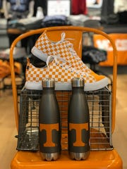 Tailgate in Market Square is selling orange and white checkerboard Skicks shoes.