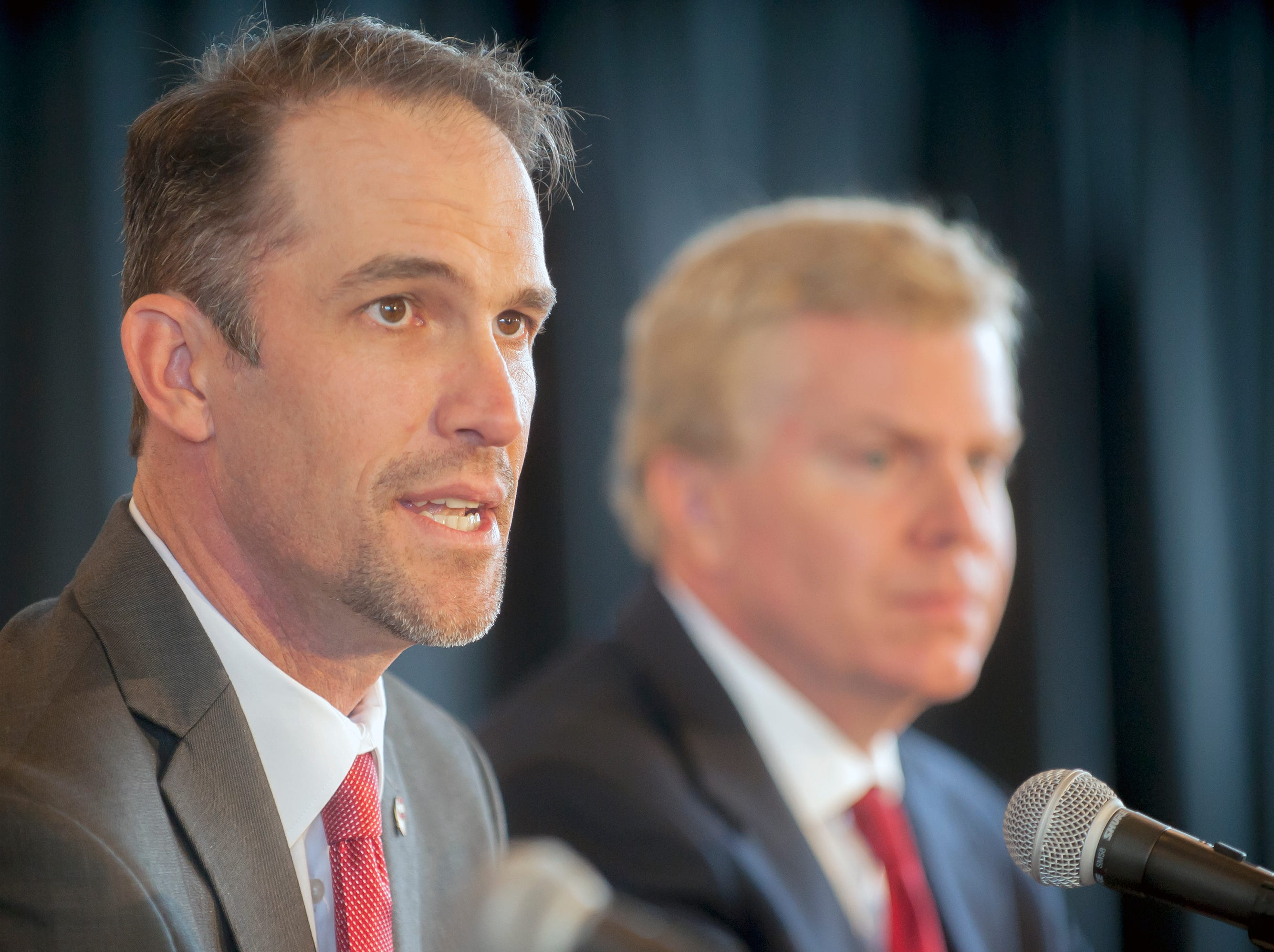Western Kentucky's new head football coach Tyson Helton (left) speaks as athletic director Todd Stewart listens during an NCAA college football press conference, Tuesday, Nov. 27, 2018, at the Jack and Jackie Harbaugh Stadium Club at Houchens-Smith Stadium in Bowling Green, Ky.