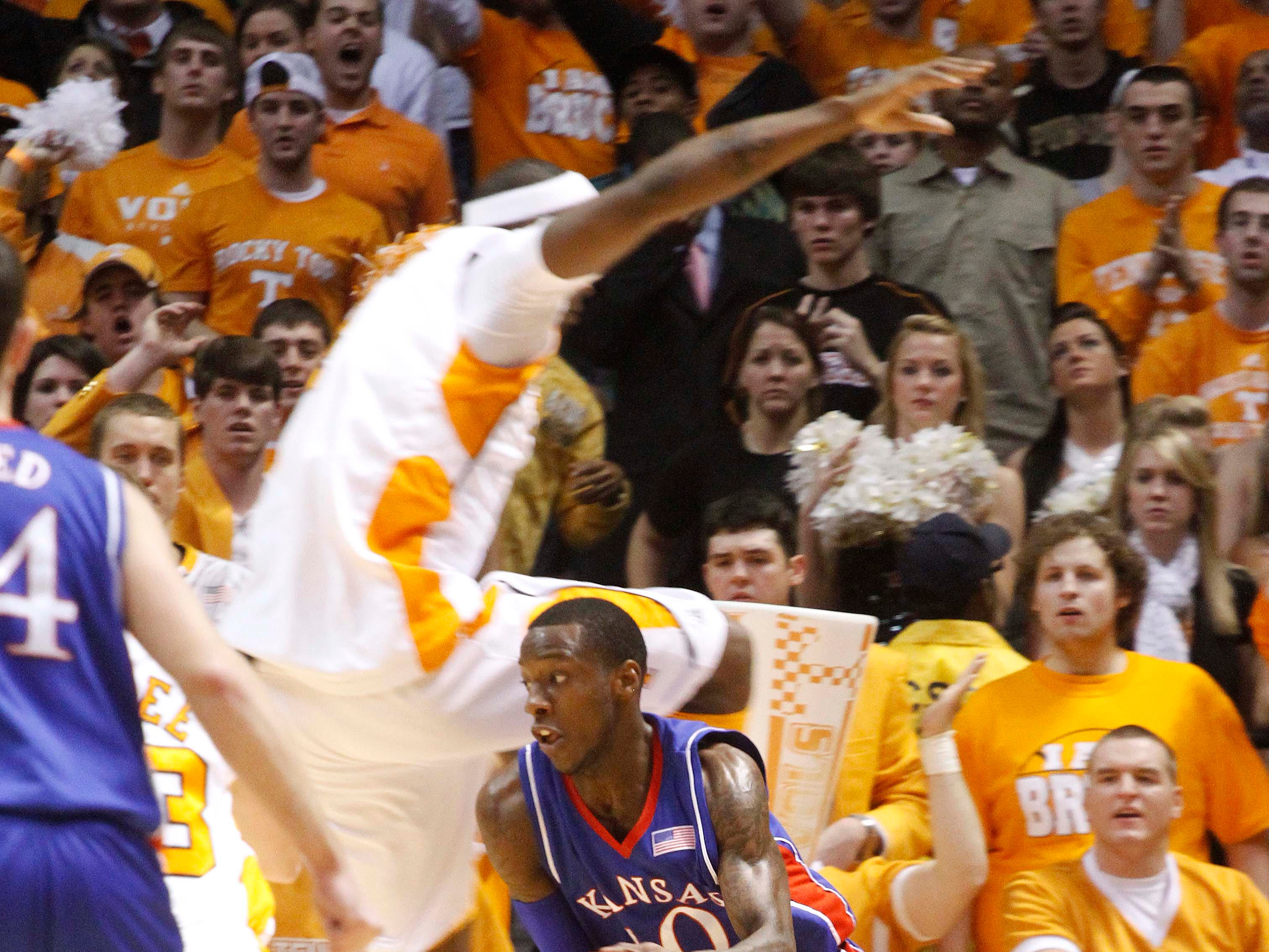 Kansas' Tyshawn Taylor (10) drives to the basket against a Tennessee player during the first half of an NCAA college basketball game Sunday, Jan. 10, 2010 in Knoxville, Tenn.