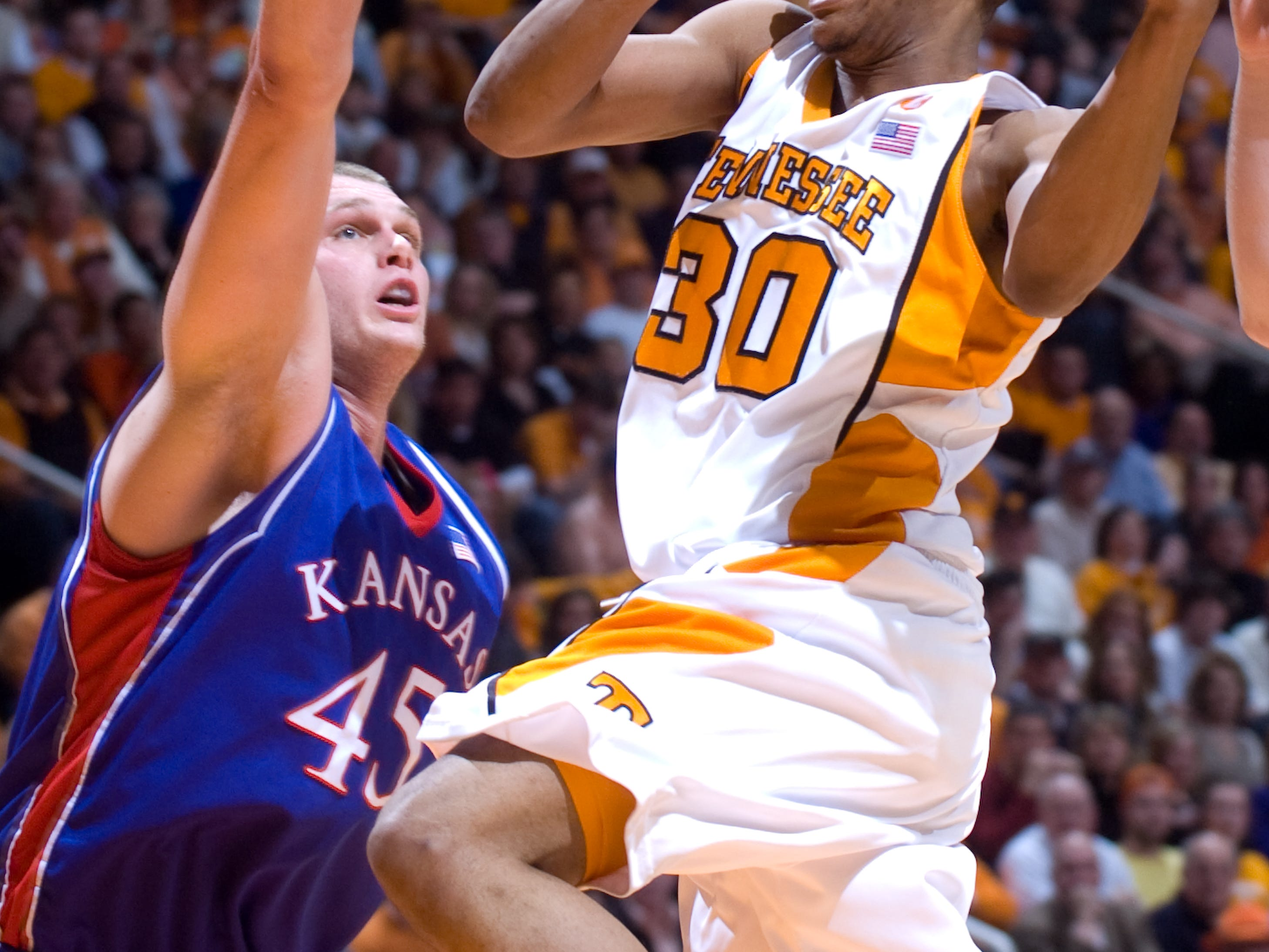 J.P. Prince drives towards the basket as Kansas' Cole Aldrich tries to defend. Tennessee upsets number one ranked  Kansas 76-68 at Thompson-Boling Arena  Sunday, Jan 10, 2010.