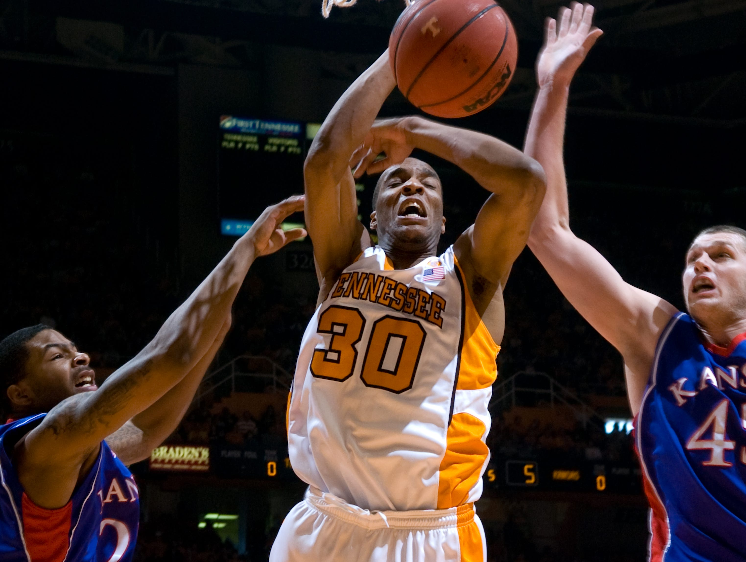 J.P. Prince loses control of the ball under Kansas defenders Marcus Morris, left, and Cole Aldrich. Tennessee upsets number one ranked  Kansas 76-68 at Thompson-Boling Arena  Sunday, Jan 10, 2010.