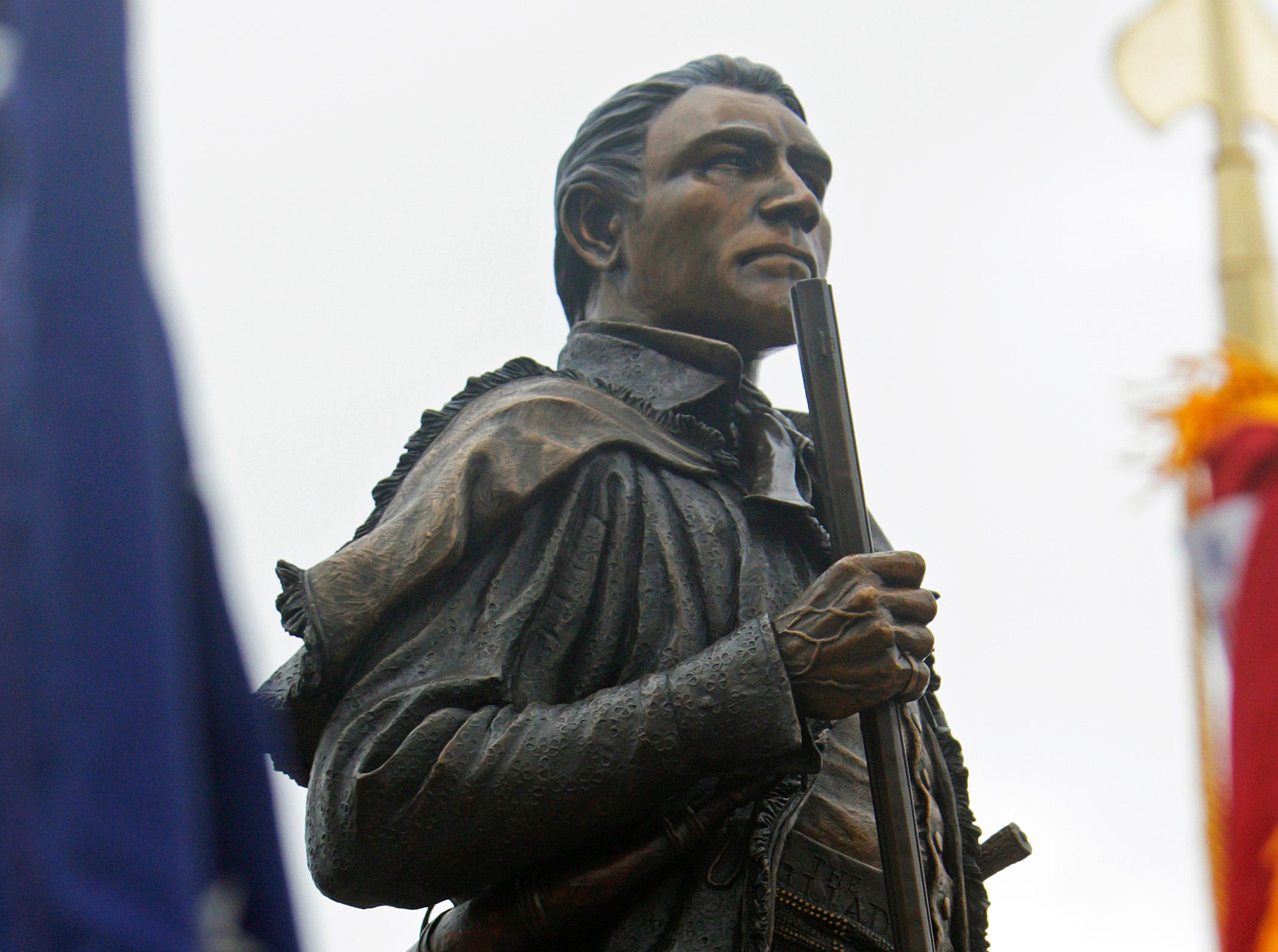 The Sam Houston statue stands between flags during an unveiling Saturday, March 19, 2016, in Maryville, Tenn.